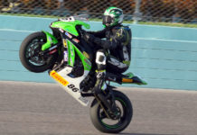 Jason Farrell (86) wheelies the Farrell Performance Kawasaki ZX-10R to the checkered flag in the ASRA Team Challenge at Homestead-Miami Speedway. Photo by Rick Hentz.