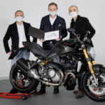 Ducati CEO Claudio Domenicali (right) and Ducati Design Center Director Andrea Ferraresi (left) deliver the 350,000th Ducati Monster to its new owner Sebastien Francois Yves Hervé De Rose (center). Photo courtesy Ducati.