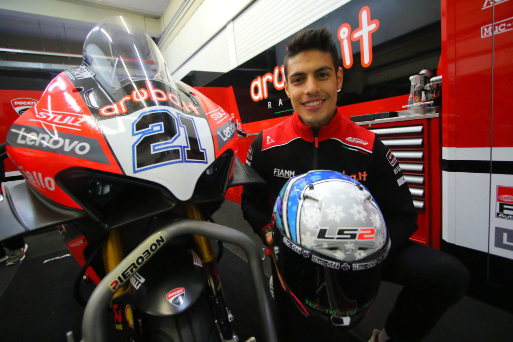 Michael Ruben Rinaldi shows off his new helmet and new Aruba.it Racing Ducati. Photo courtesy Dorna WorldSBK Press Office.