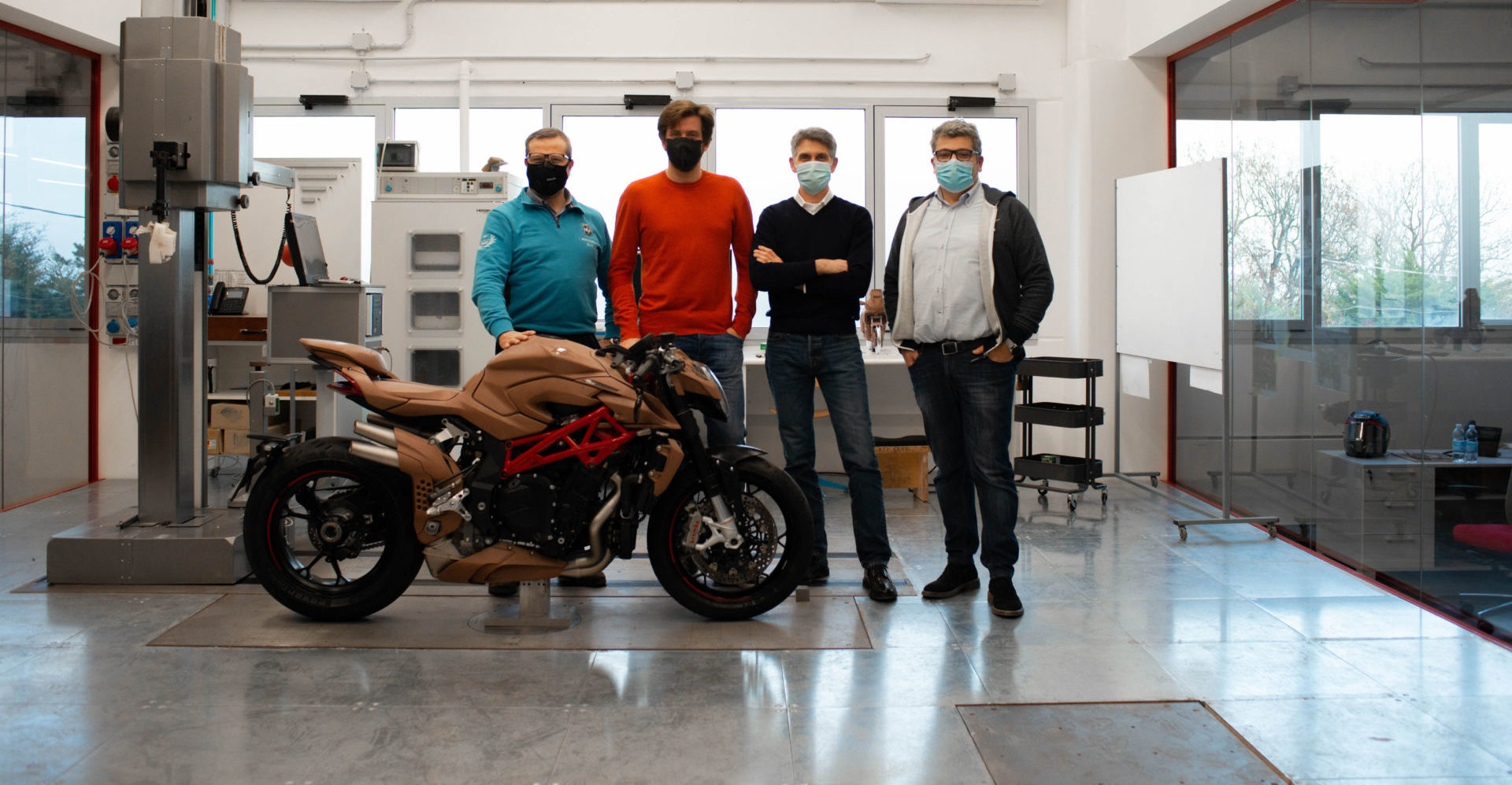 (From left) Alessandro Volpini, Timur Sardarov, Brian Gillen and Giorgio Mazzotti at MV Agusta's new design center in San Marino. Photo courtesy MV Agusta.