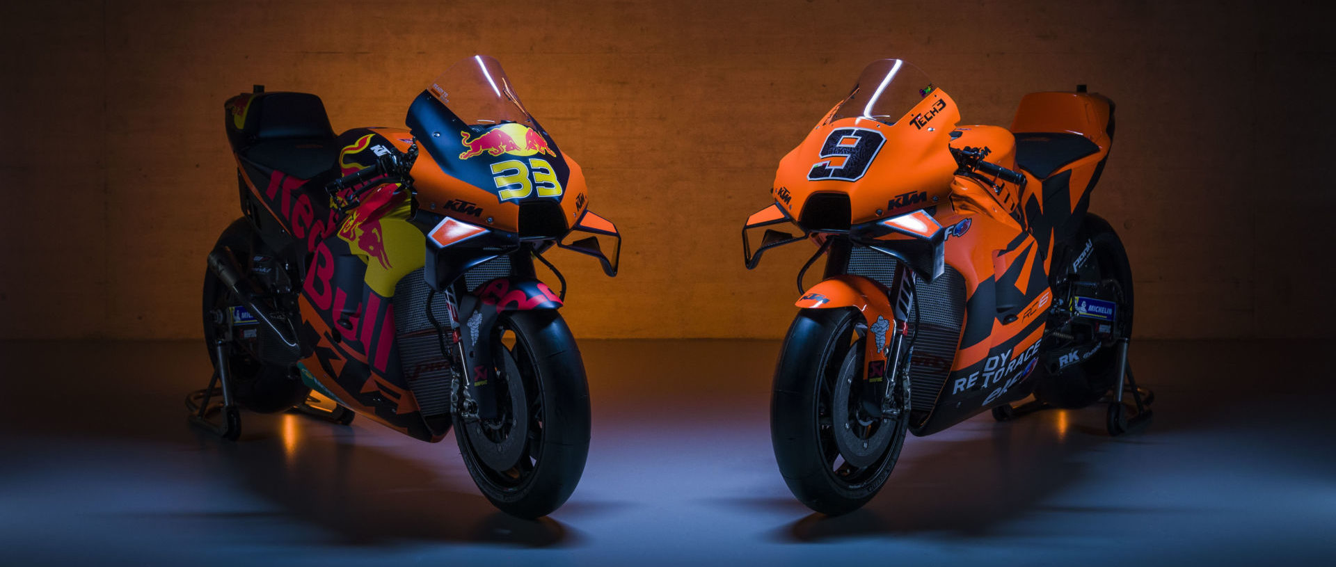 The 2021 KTM RC16 MotoGP racebikes of Brad Binder (33) and Danilo Petrucci (9). Photo by Sebas Romero, courtesy KTM Factory Racing.