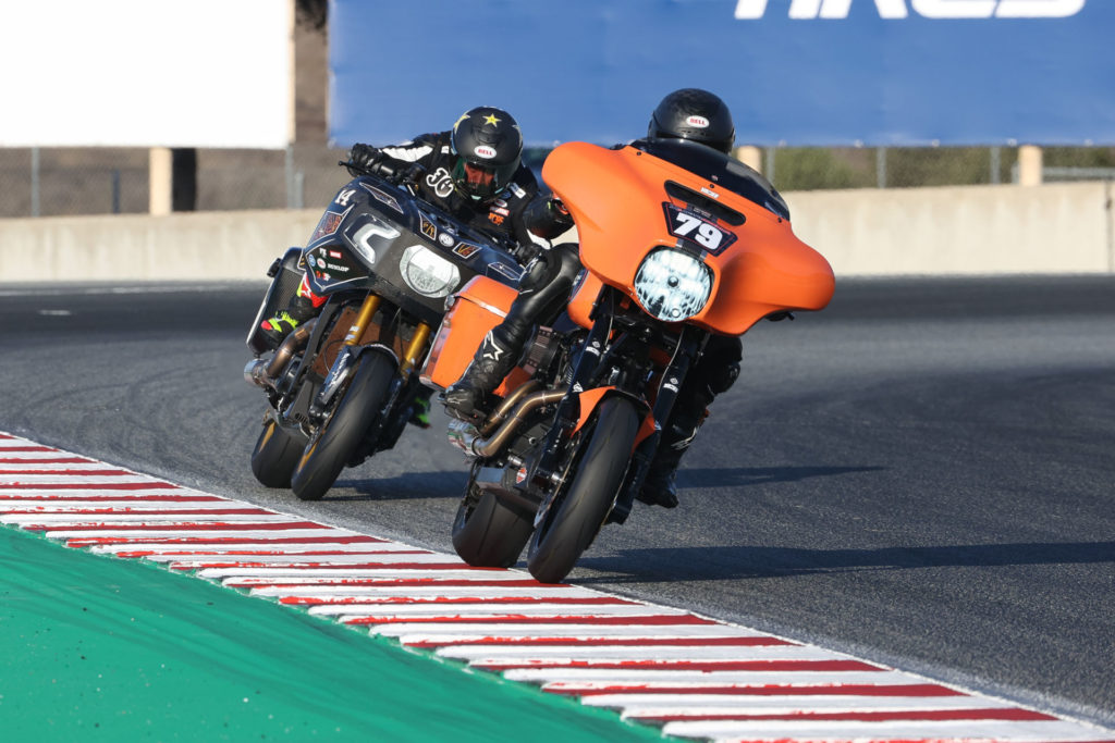 Hayden Gillim (79), riding a Vance & Hines Harley-Davidson Electra Glide Standard, and Frankie Garcia (14), riding a RSD Indian Challenger, battle for second place in the MotoAmerica King of the Baggers race at Laguna Seca. Photo by Brian J. Nelson.