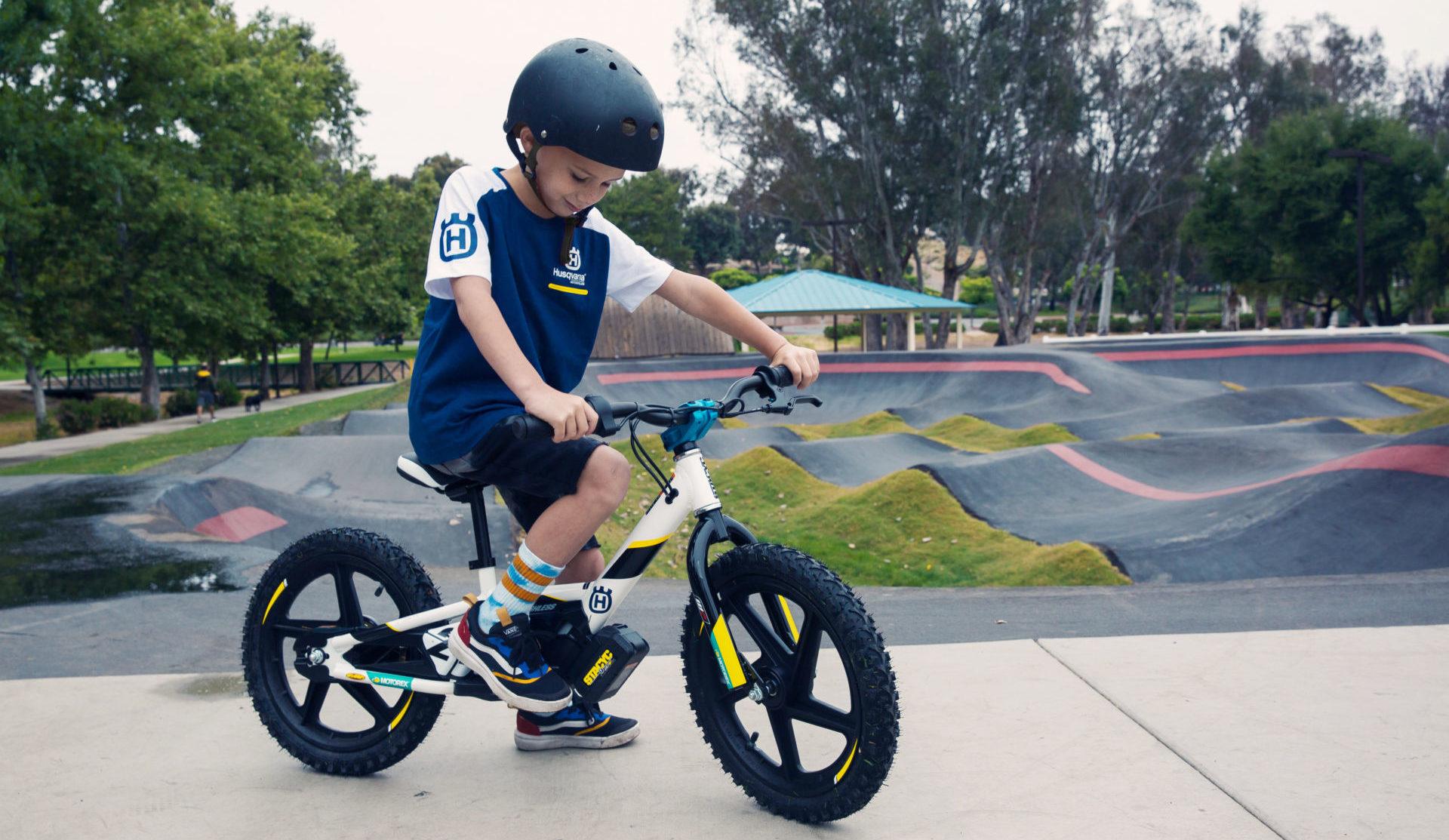 A young boy on a Husqvarna 16eDrive electric balance bike. Photo courtesy Husqvarna Motorcycles.