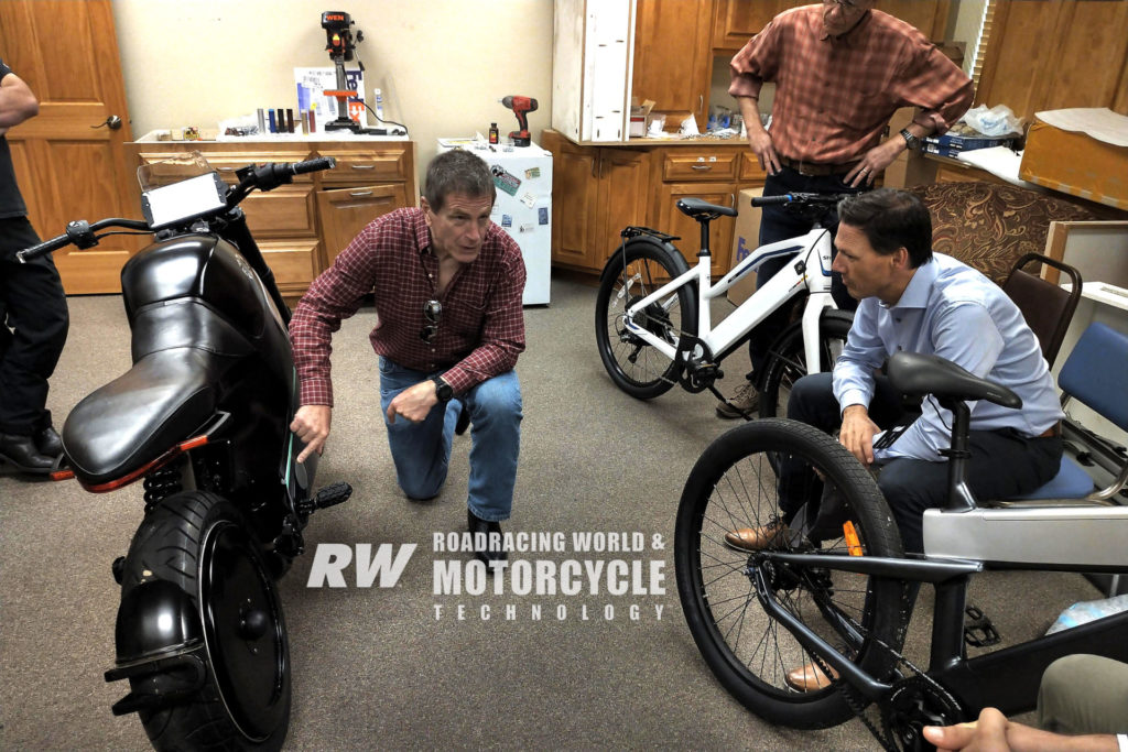 Erik Buell (center, kneeling) discussing a FUELL Flow electric motorcycle with FUELL engineers. Photo courtesy FUELL.