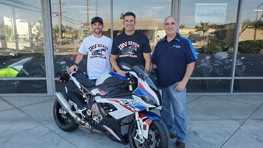 (From left) Travis Wyman Racing team owner Travis Wyman, BMW HP Race Engineer Steve Weir, and Irv Seaver BMW General Manager David Diaz. Photo courtesy Travis Wyman Racing.