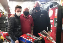 DSP HondaGeneral Manager John Lawson (right) and Parts Associate Gary Landow(center) with racer Damian Jigalov (left). Photo by Adrian Jigalov.
