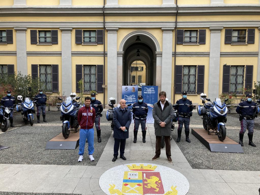(From left) MV Agusta Moto2 racer Simone Corsi, Milan Police Commissioner Giuseppe Petronzi, and MV Agusta CEO Timur Sardarov at police headquarters in Milan, Italy. Photo courtesy MV Agusta.