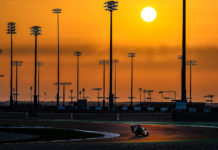 Aleix Espargaro rides through the twilight at Losail International Circuit, in Qatar. Photo courtesy Dorna.