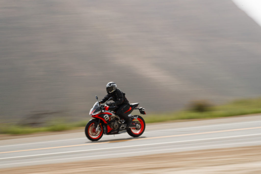 The Aprilia Tuono 660's riding position is more upright than that of the sister RS 660, but is still comfortable at speed. The abbreviated bodywork provides good wind protection and well-incorporated downforce elements at the front. Photo by Larry Chen.