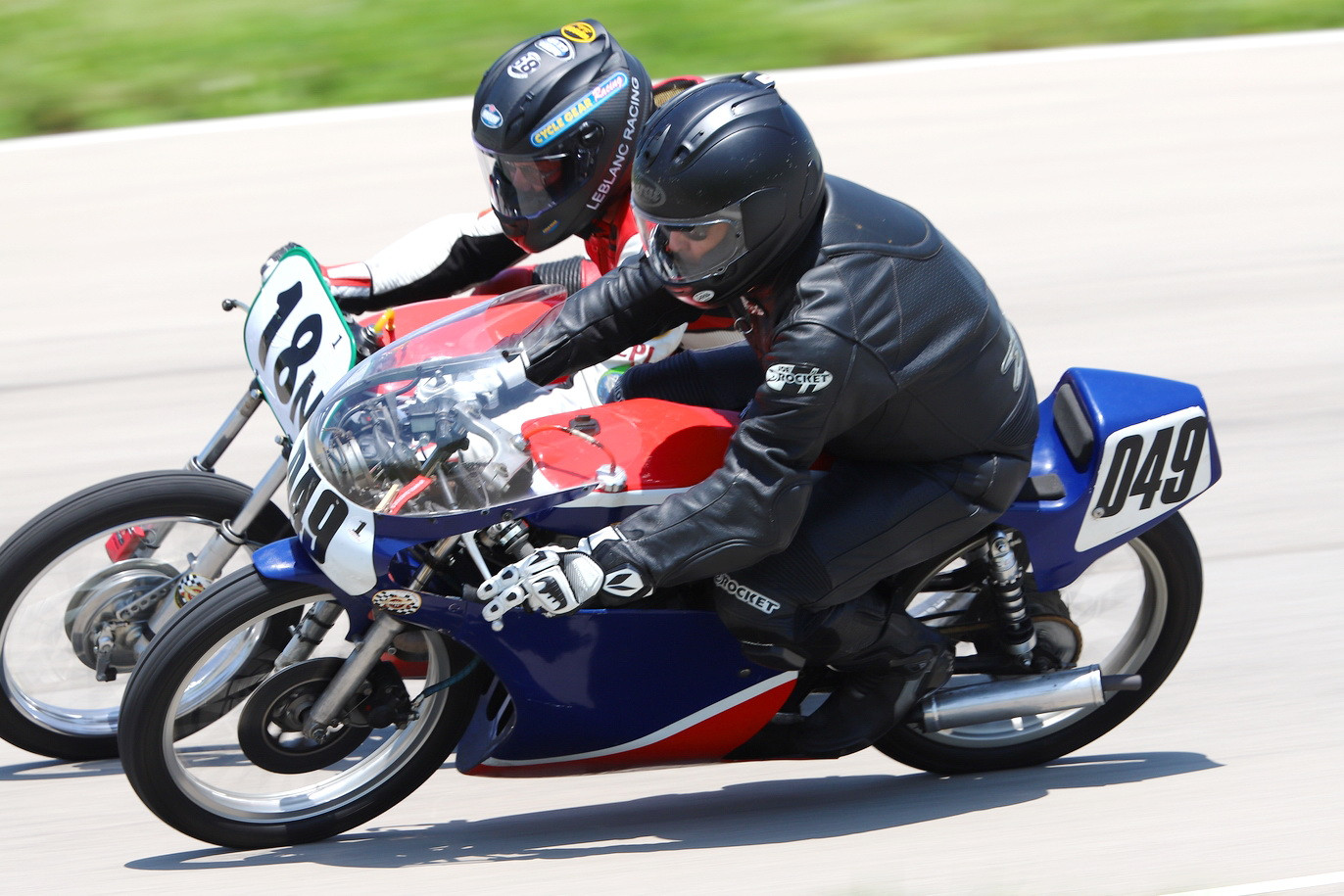 AHRMA racers Danny Habermel (049) and Louis LeBlanc (18N) in action. Photo by etechphoto.com, courtesy AHRMA.
