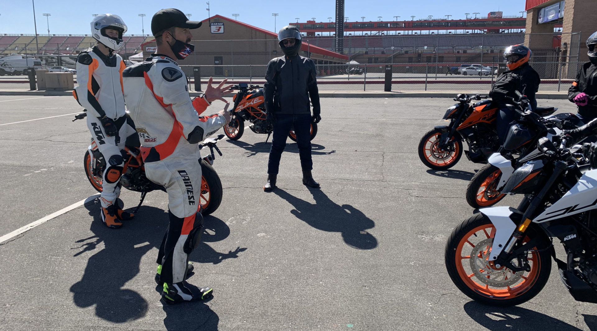 Coaches with riders on KTM motorcycles. Photo courtesy USMCA.