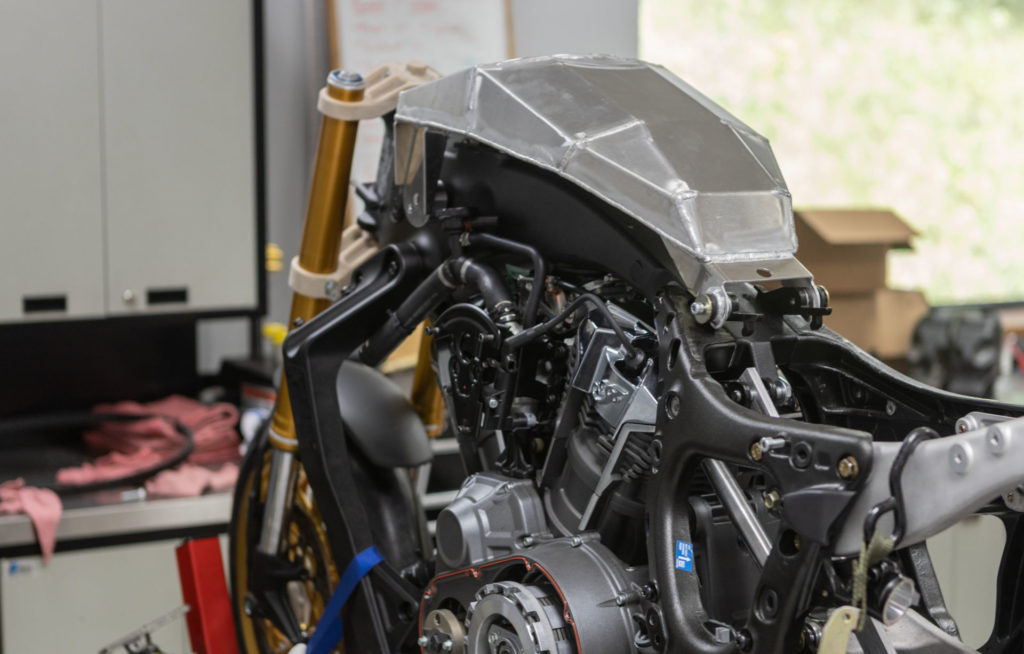 A small, custom, aluminum fuel cell is hidden under a carbon fiber cover that mimics the stock fuel tank. Photo courtesy S&S Cycle and MotoAmerica.