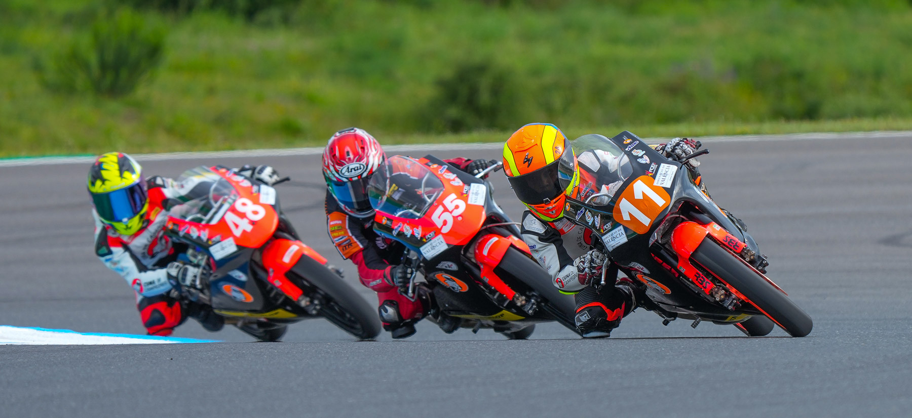 American Mikey Lou Sanchez (55) sandwiched in between Oliver Cantos Llorca (11) and Vasco Cesar Fonseca (48) during Cuna de Campeones Moto 5 Race Two at Portugal. Llorca won the race, and Sanchez crashed out while battling for the lead. Photo courtesy Sanchez Racing.