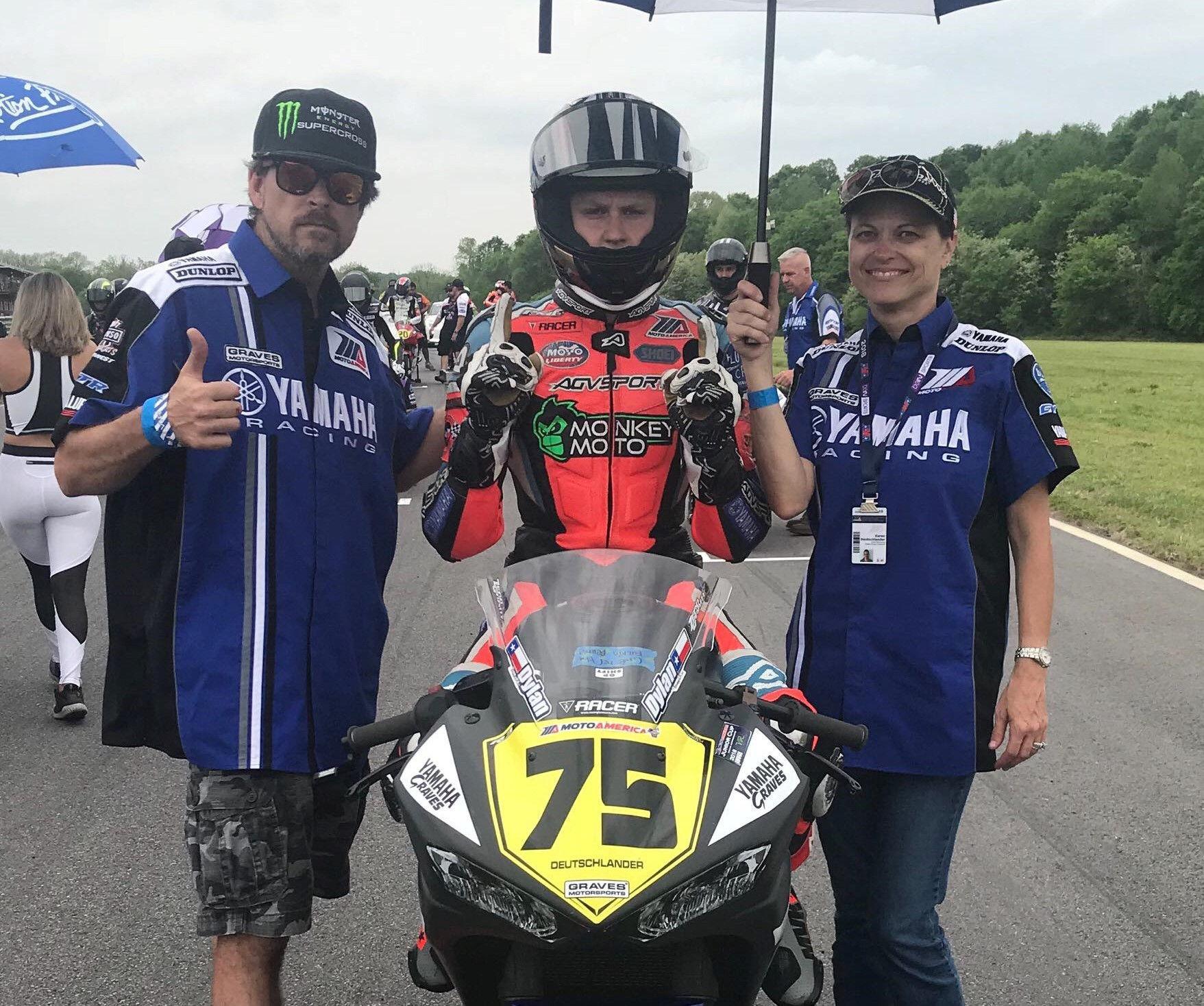 Karen Deutschlander (right) on the grid with son Dylan Deutschlander (center) at a MotoAmerica race. Photo by Brian J. Nelson.