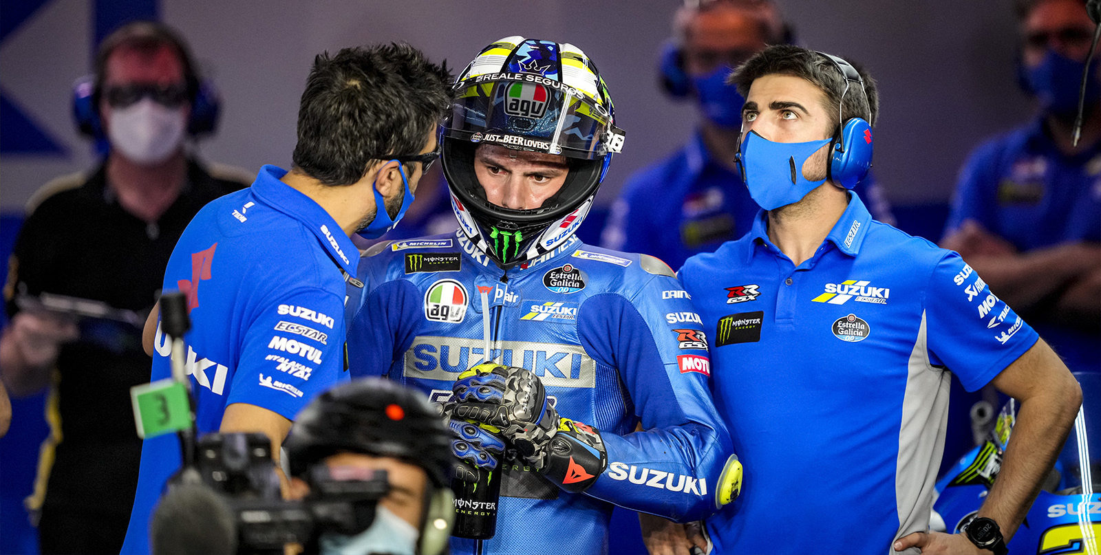 Joan Mir (center) with his Crew Chief Frankie Carchedi (left) and another crew member in Qatar. Photo courtesy Suzuki ECSTAR Team.