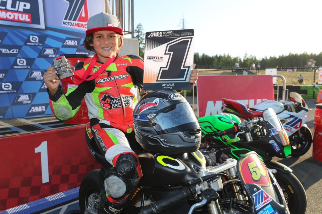 Mikey Lou Sanchez with one of his MotoAmerica/AMA Mini Cup #1 plates. Photo by Brian J. Nelson.