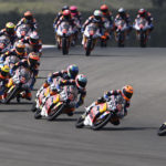 David Alonso (80) leads the start of Red Bull MotoGP Rookies Cup Race 2 in Portugal. Photo courtesy Red Bull.