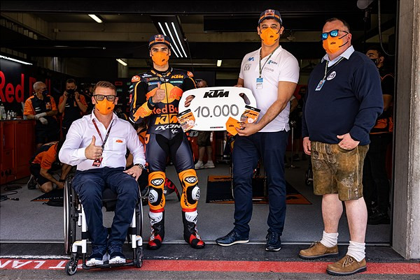 (From left) KTM Motorsports Director Pit Beirer, MotoGP racer Miguel Oliveira, Nuno Andrade (Medika S.A.), and Josef Joachimbauer (JFJ Consulting GmbH). Photo courtesy KTM.