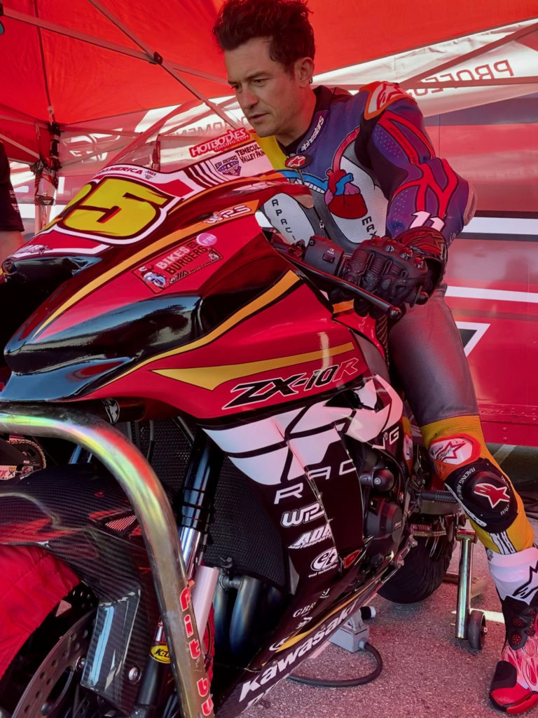 Actor Orlando Bloom prepares to go out on track on a FLY Racing/ADR Motorsports Kawasaki ZX-10RR Superbike. Photo courtesy Alpinestars.