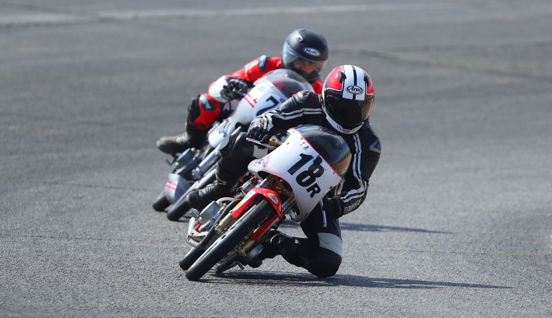 Gabriel Droetti (18R) leading another AHRMA rider during a 200GP race at Willow Springs International Raceway. Photo by etechphoto.com, courtesy AHRMA.