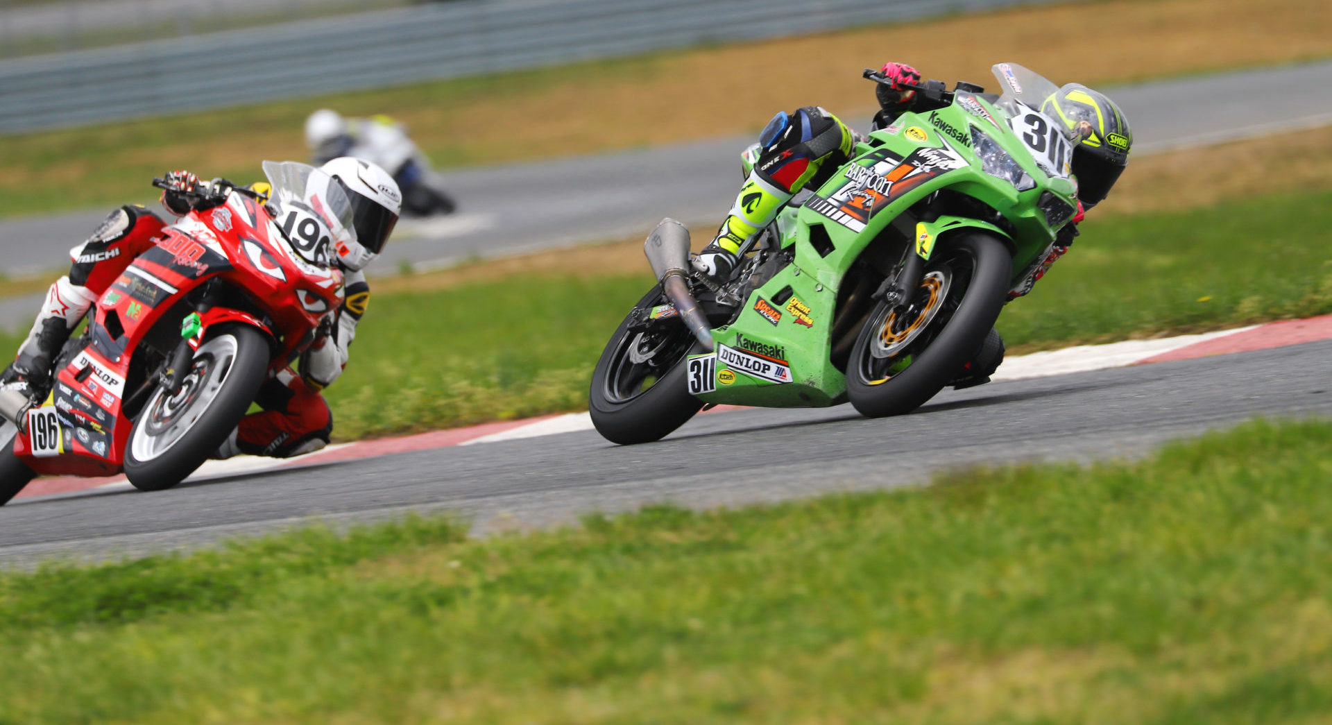 Kayla Yaakov (311) leads Gus Rodio (196) during the ASRA Moto3 National at New Jersey Motorsports Park. Photo by etechphoto.com, courtesy ASRA.