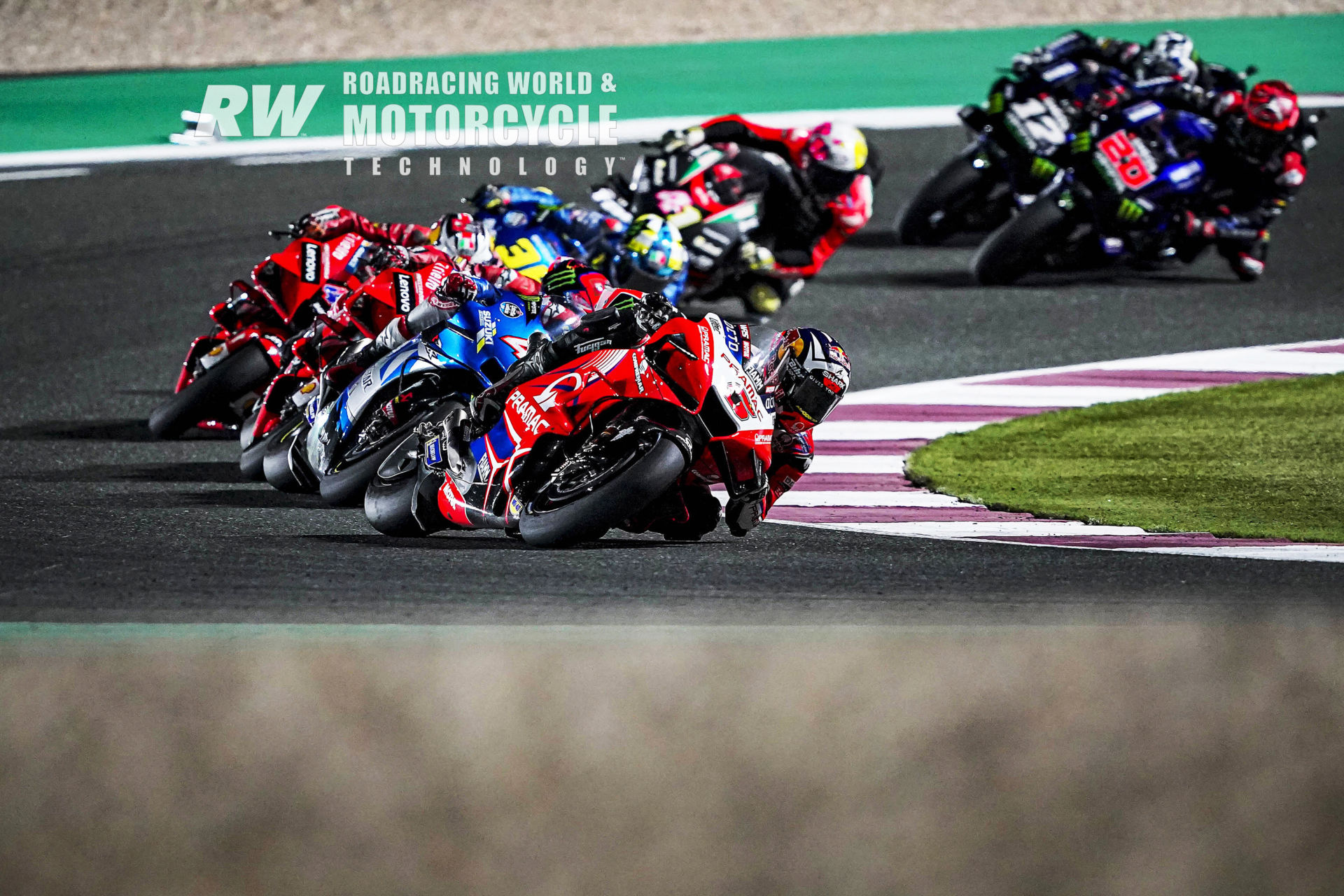Second-quickest qualifier Johann Zarco (5) chases pole-sitter Jorge Martin (already out of the frame) and leads Alex Rins (42), Francesco Bagnaia, Jack Miller, Joan Mir (36) Aleix Espargaró (41), Fabio Quartararo (20), and Maverick Viñales (12) early in the Moto-GP race during Qatar weekend #2. Photo by DPPI Media.
