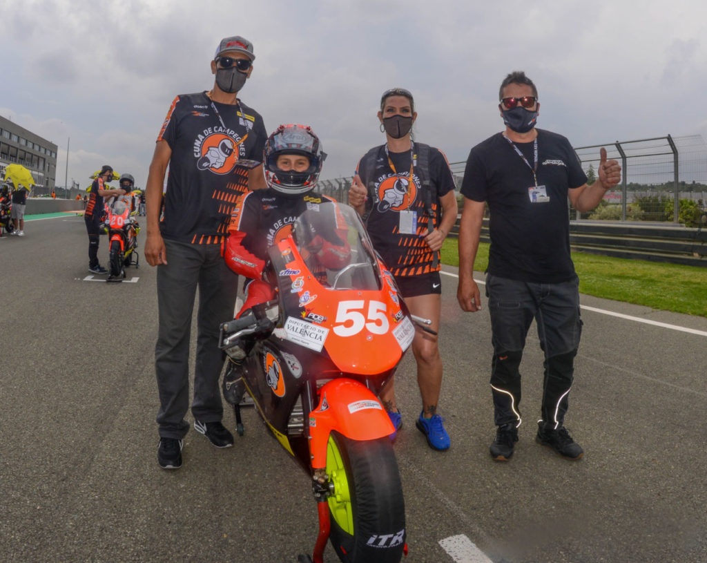 Mikey Lou Sanchez (55) on the the grid in Spain with (from left) father Michael Sanchez, mother Trinity Richardson, and trainer Jose Pino. Photo courtesy Sanchez Racing.