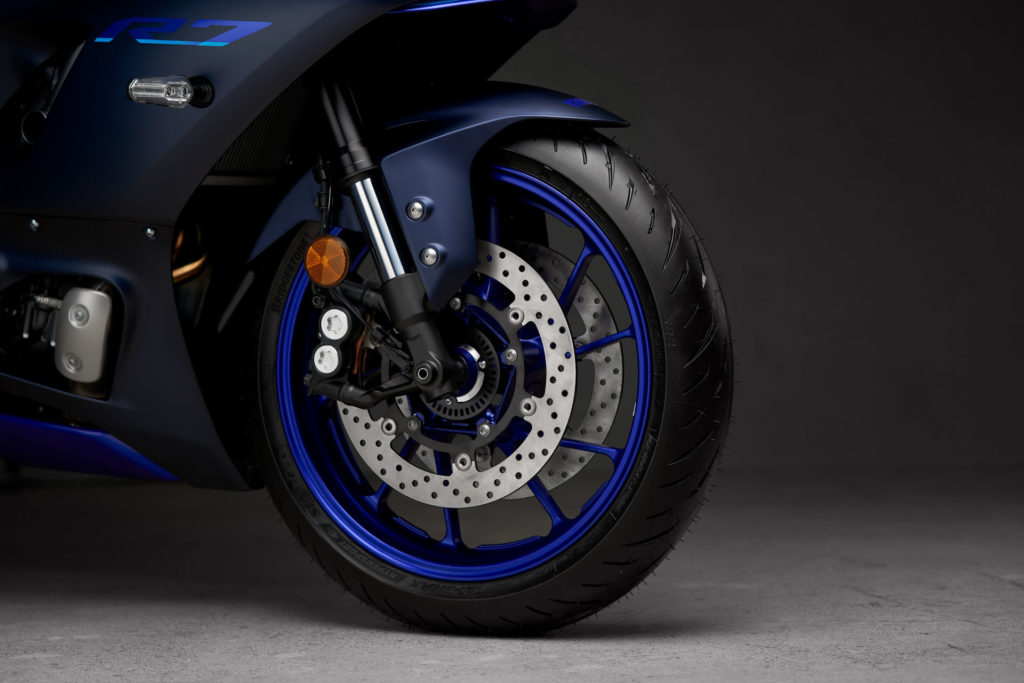 The front braking system on the 2022-model Yamaha YZF-R7 includes dual 298mm discs and four-piston radial-mount calipers. Photo courtesy Yamaha.
