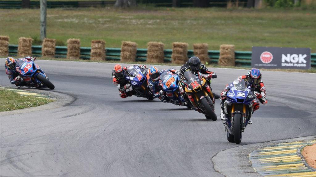 Jake Gagne (32) leads Mathew Scholtz (11), Bobby Fong (50), Josh Herrin (2), and Cameron Petersen (45) early in MotoAmerica Superbike Race One. Photo by Brian J. Nelson, courtesy MotoAmerica.