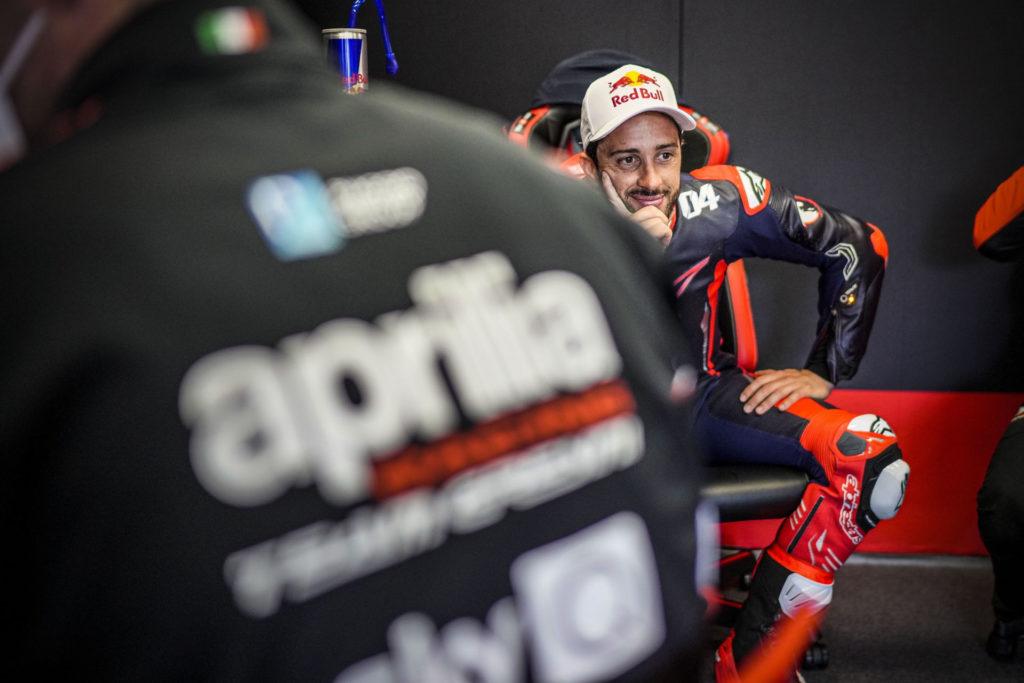 Andrea Dovizioso smiling in the garage at Mugello. Photo courtesy Aprilia.