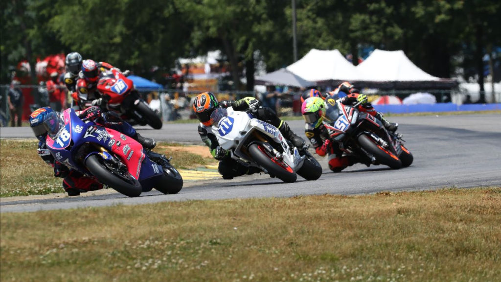 Jackson Blackmon (18), Jody Barry (717), Kaleb De Keyrel (51), and Trevor Standish (16) battle at the front during Twins Cup Race Two. Photo by Brian J. Nelson, courtesy MotoAmerica.