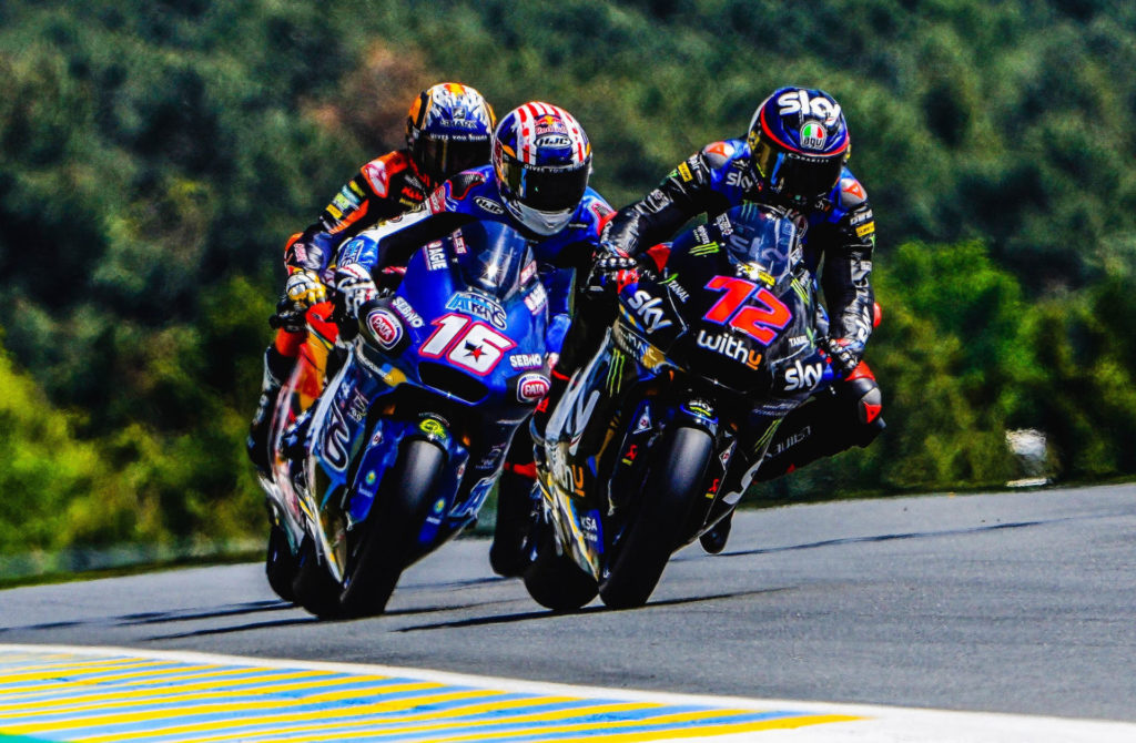 Joe Roberts (16) battling Marco Bezzecchi (72) and Raul Fernandez for the lead in the Moto2 race at Le Mans. Photo courtesy Italtrans Racing.
