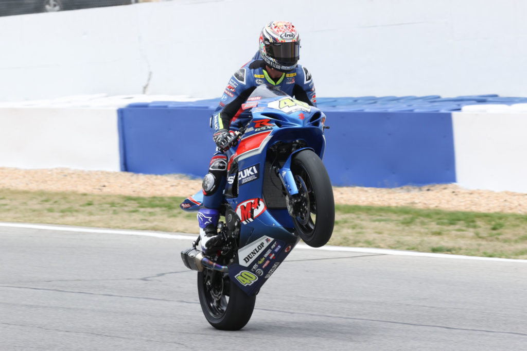 Sean Dylan Kelly wheelies his M4 ECSTAR Suzuki after winning the Supersport race for the second day in a row on Sunday. Photo by Brian J. Nelson