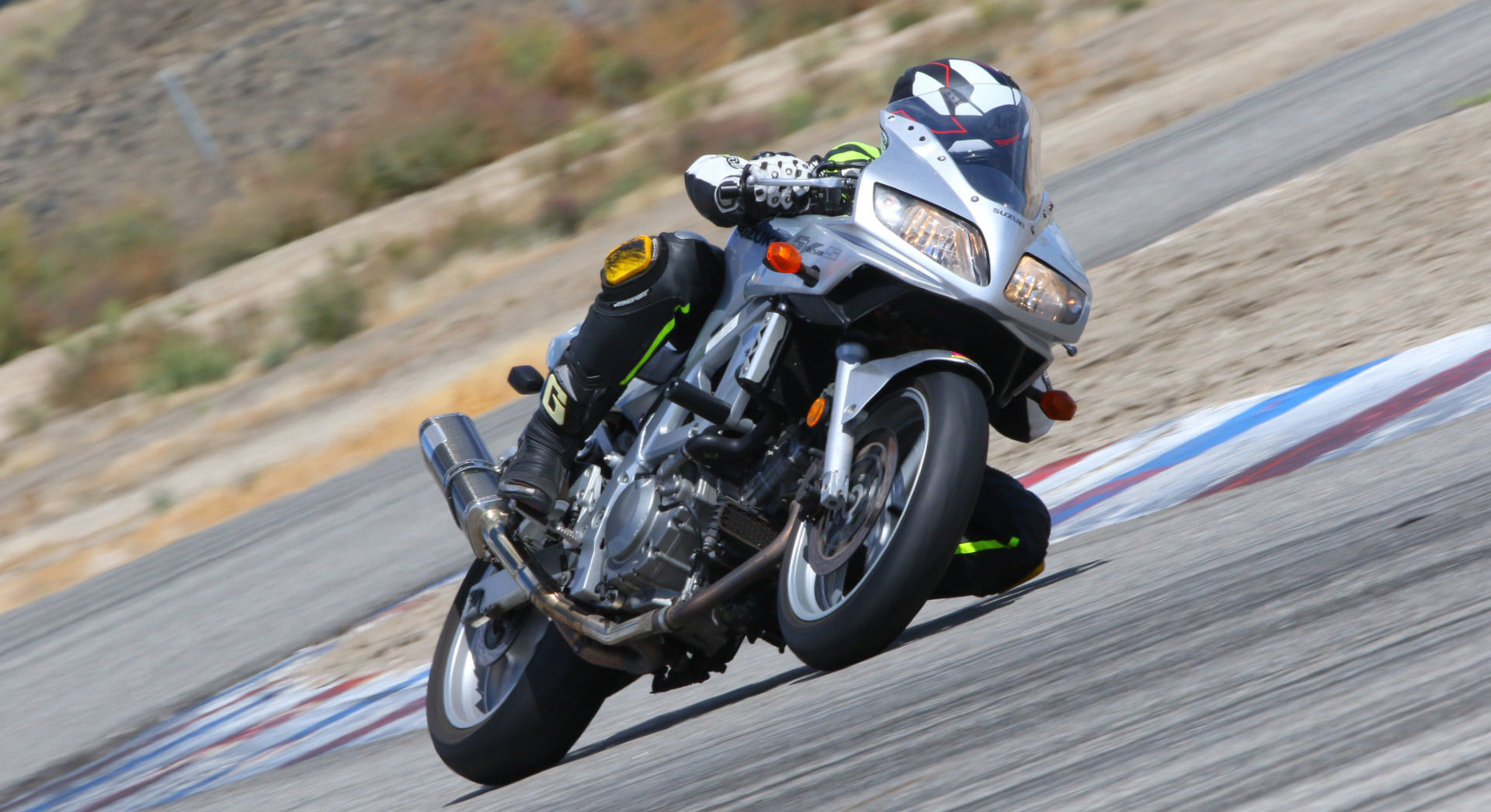 Even a well-used set of good performance radials can serve you well at a track day. The author on his beloved bargain blaster Suzuki SV650 with a set of year-old Dunlop RoadSport 2 radials at Buttonwillow Raceway Park. Photo by CaliPhotography.com.