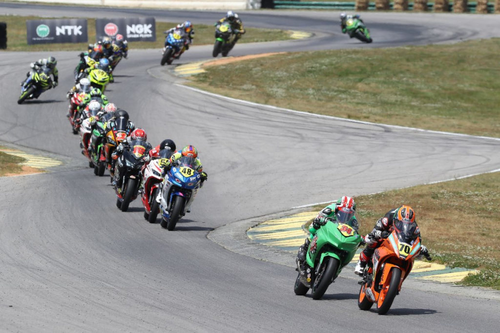 Tyler Scott (70) leads Cody Wyman (34), Max VanDenBrouck (48) and the rest of the field early in Junior Cup Race Two. Photo by Brian J. Nelson, courtesy MotoAmerica.
