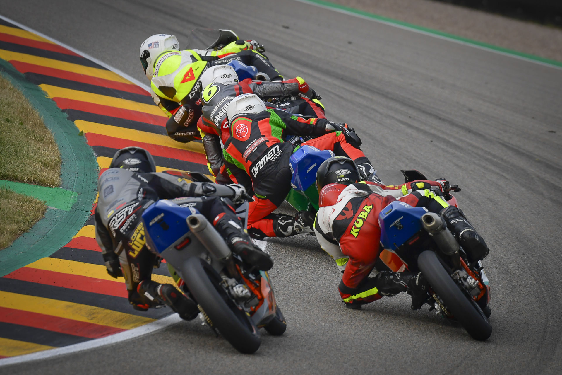 Action from Northern Talent Cup Race One at Sachsenring, with Hungarian American Rossi Moor leading. Photo courtesy Dorna.