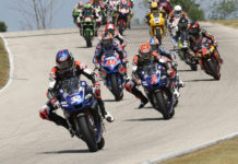 Jake Gagne (32) leads Josh Herrin (2), Cameron Petersen (45), and the rest of the field at the start of MotoAmerica Superbike Race One at Road America. Photo by Brian J. Nelson.