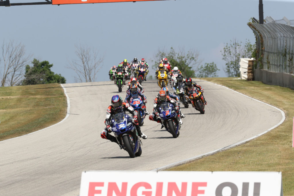 Jake Gagne (32) leads the start of MotoAmerica Superbike Race One at Road America. Photo by Brian J. Nelson.