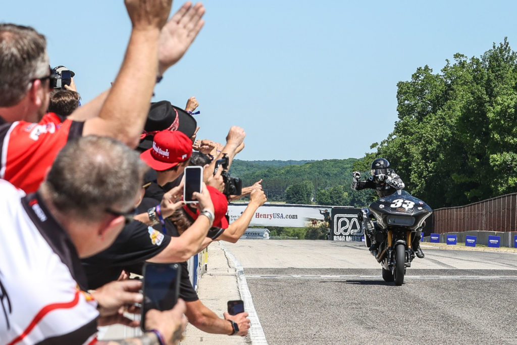 Kyle Wyman (33) acknowledging his crew along pit wall as he takes the checkered flag at Road America. Photo by Brian J. Nelson, courtesy Harley-Davidson.