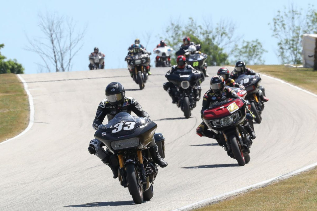 Kyle Wyman (33) leads Tyler O'Hara (29) and the King of the Baggers field at Road America. Photo by Brian J. Nelson.