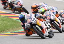 Matteo Bertelle (28) leads Ivan Ortola (24), Marcos Uriarte (89), and the rest of the Red Bull MotoGP Rookies Cup field during Race Two at Sachsenring. Photo courtesy Red Bull.
