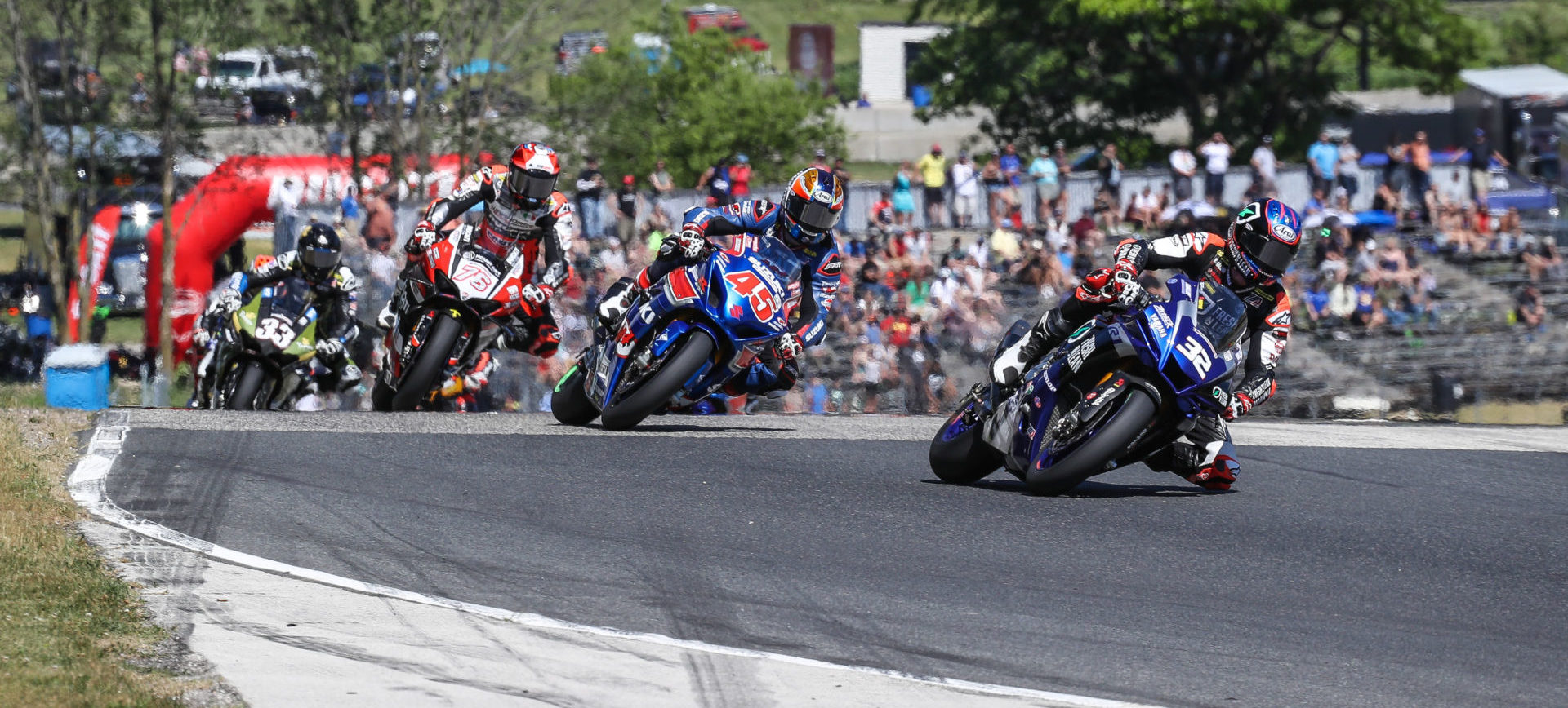 Jake Gagne (32) leads Cameron Petersen (45), Loris Baz (76) and Kyle Wyman (33) early in MotoAmerica Superbike Race Two. Photo by Brian J. Nelson.