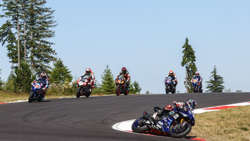 Jake Gagne (32) leads Cameron Petersen (45), Loris Baz (76), Mathew Scholtz (11), Josh Herrin (2) and Bobby Fong (50) at the start of Superbike Race One.  Photo by Brian J. Nelson, courtesy of MotoAmerica.