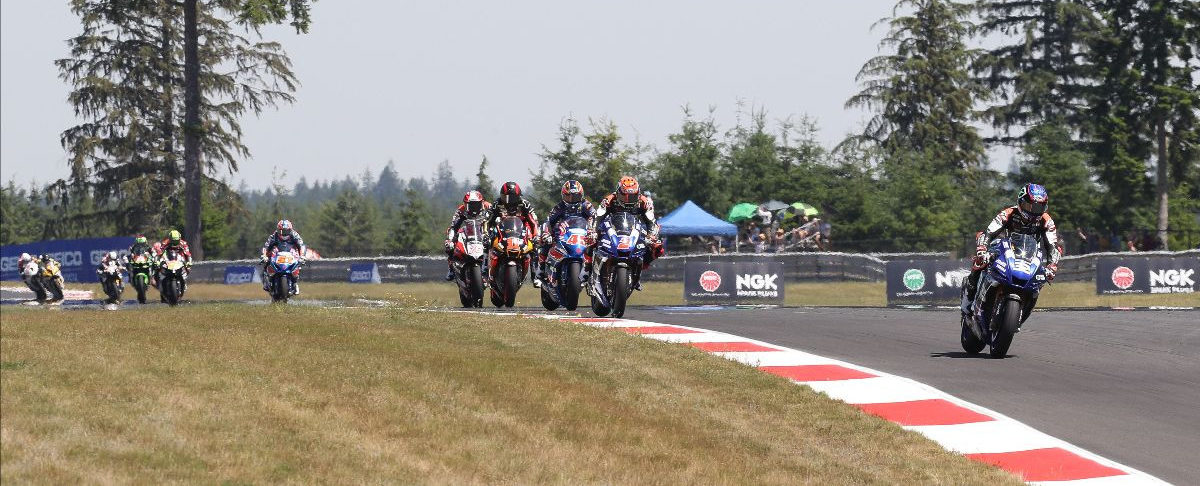 Jake Gagne (32) leads Josh Herrin (2), Cameron Petersen (32), Mathew Scholtz (11), Loris Baz (76), Bobby Fong (50), and the rest of the field early in Superbike Race Two at Ridge Motorsports Park. Photo by Brian J. Nelson, courtesy MotoAmerica.