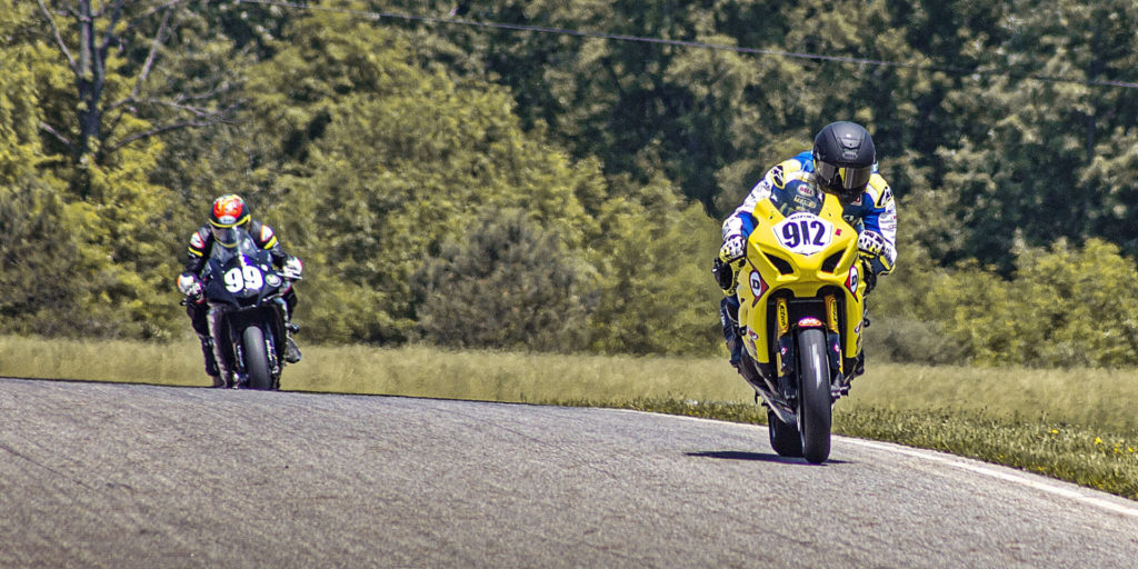 Twisted Speed Racing's Hayden Gillim (912) leads Army Of Darkness (99) en route to its second straight N2/WERA National Endurance Series By Dunlop Heavyweight victory. Photo by Justin Friedl, courtesy Twisted Speed Racing.