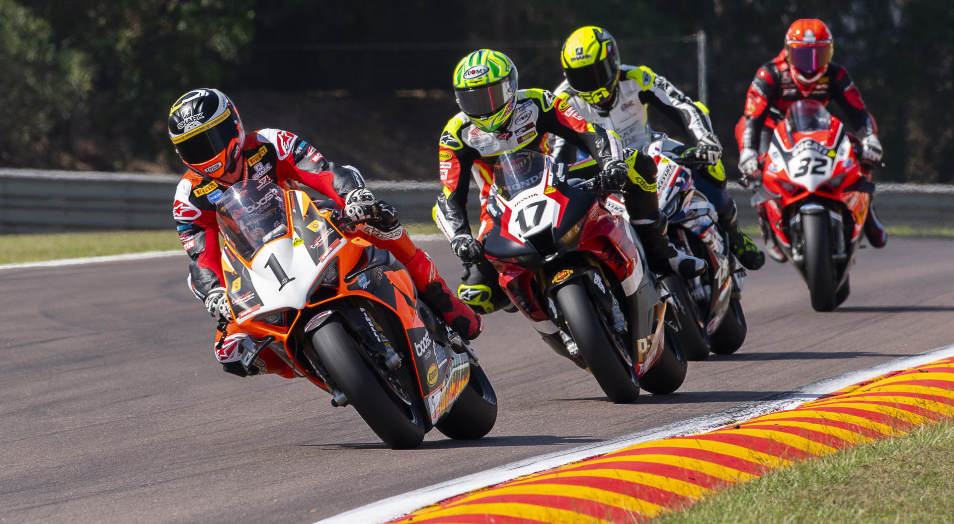Wayne Maxwell (1) leads Troy Herfoss (17), Glenn Allerton (behind Herfoss), and Oli Bayliss (32) during Race One at Hidden Valley Raceway. Photo by Optikal Phtoography, courtesy ASBK.
