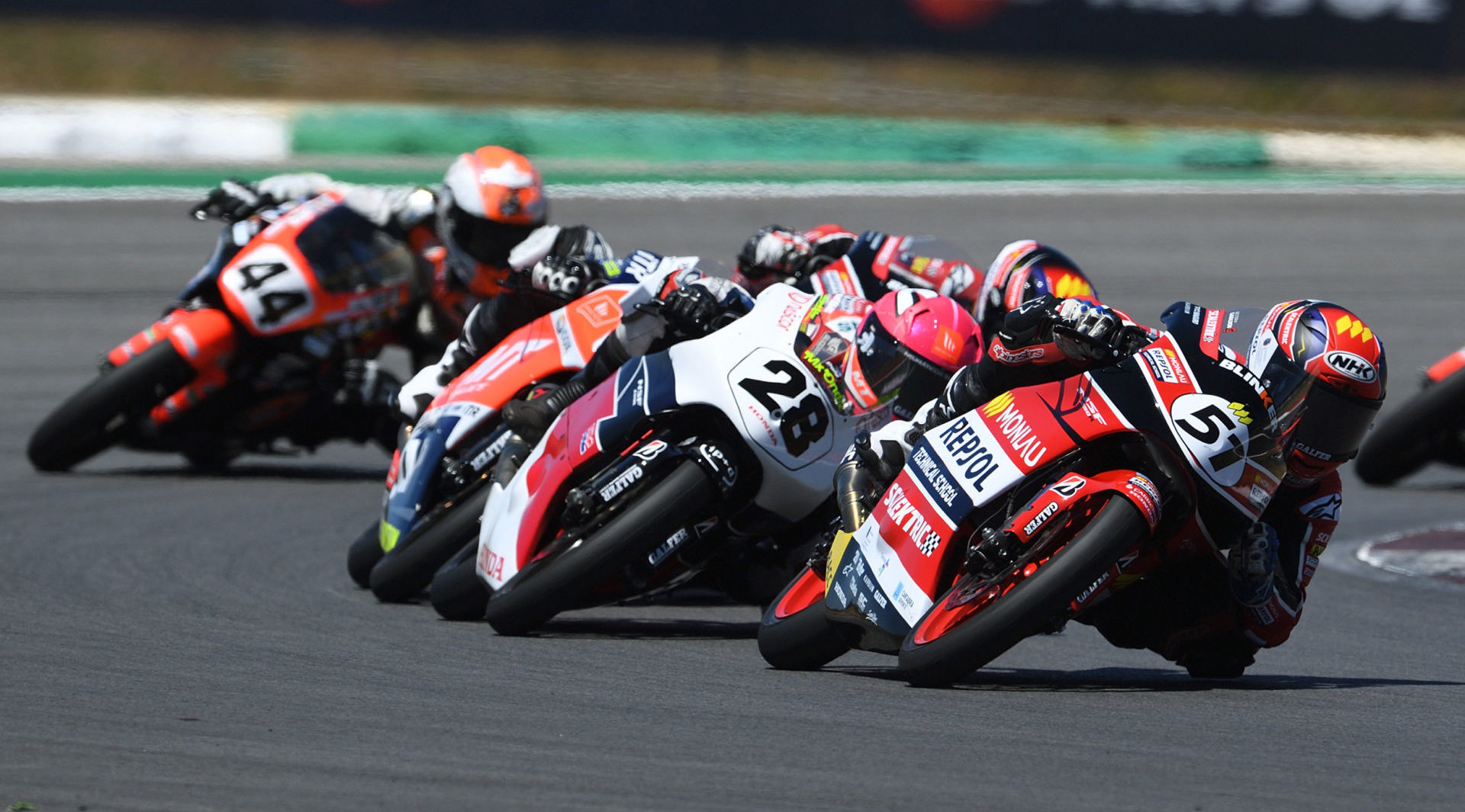 Brian Uriarte (51) leads Maximo Martinez (28) and a group of other riders during the Hawkers European Talent Cup race in Portugal. Photo courtesy FIM CEV Repsol Press Office.