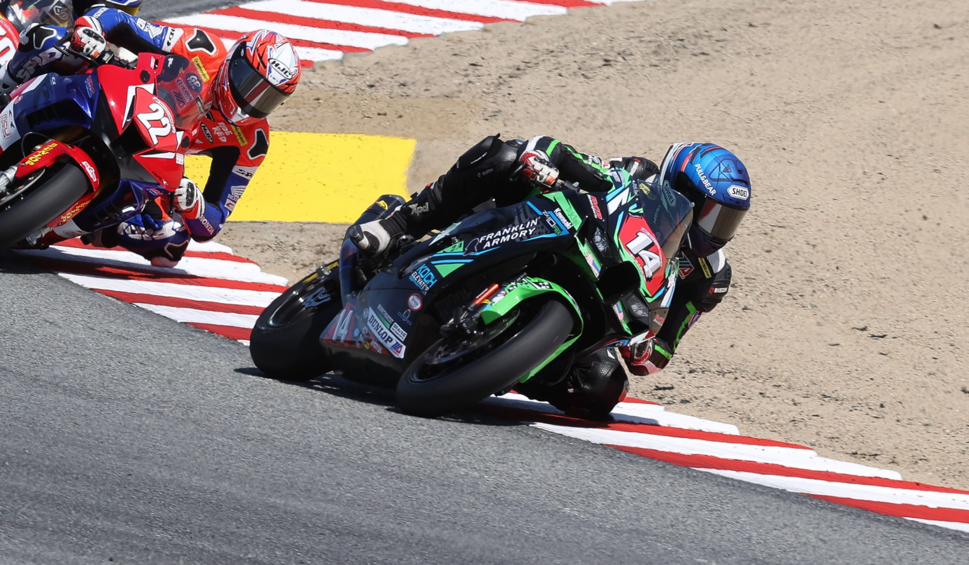 Andrew Lee (14) and Ashton Yates (22) in action at Laguna Seca. Photo by Brian J. Nelson.