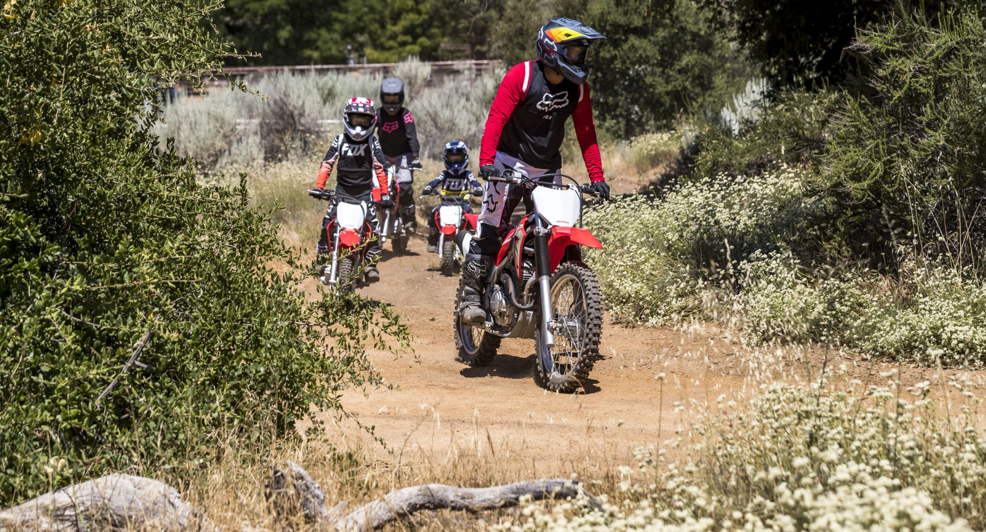 A group of riders on 2022-model Honda CRF off-road motorcycles. Photo courtesy American Honda.