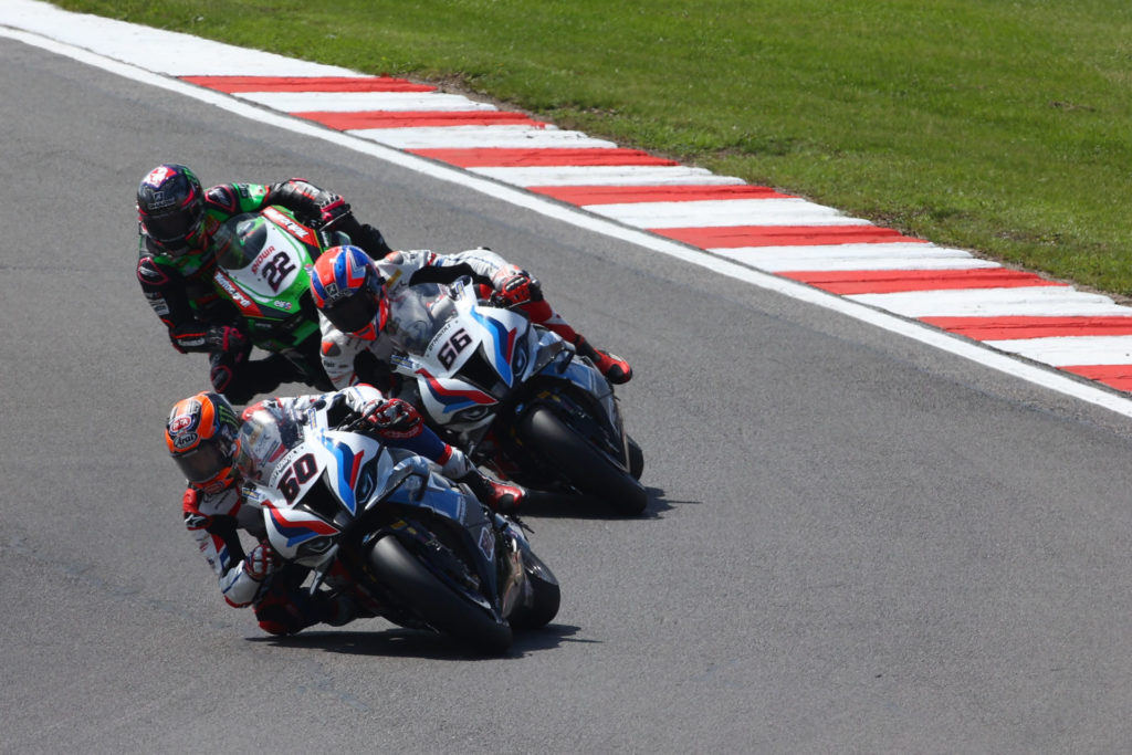 Michael van der Mark (60), Tom Sykes (66), and Alex Lowes (22) race for third. Photo courtesy Dorna.